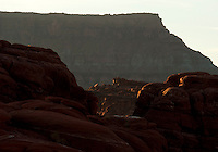 Morning light hits top of canyons near Moab, Utah.