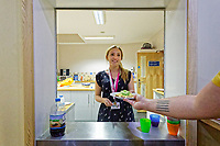 Pictured: A Centre worker hands out breakfast for users. Thursday 19 September 2019<br /> Re: Barod Substance Misuse Centre in Swansea, Wales, UK.