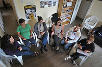 Women gather to tell their stories and help each other during a meeting at Mothers del Paco headquarters in Lomas de Zamora