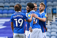 Ellis Harrison of Portsmouth middle is congratulated after scoring the second Portsmouth goal during Portsmouth vs MK Dons, Sky Bet EFL League 1 Football at Fratton Park on 10th October 2020
