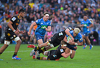 Blues' Rieko Ioane is tackled during the Super Rugby Aotearoa match between the Blues and Chiefs at Eden Park in Auckland, New Zealand on Sunday, 26 July 2020. Photo: Dave Lintott / lintottphoto.co.nz