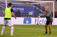 Pictured: Fernando Llorente of Swansea City warms up with Alan Curtis, First-team coach Saturday 27 August 2016<br />