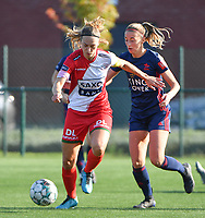Pauline Windels (5) of Zulte Waregem and Charlotte Cranshoff (18) of OH Leuven pictured during a female soccer game between SV Zulte - Waregem and Oud Heverlee Leuven on the sixth matchday of the 2021 - 2022 season of Belgian Scooore Womens Super League , saturday 9 of October 2021  in Zulte , Belgium . PHOTO SPORTPIX | DIRK VUYLSTEKE