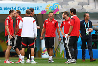 Lukas Podolski of Germany enjoys a joke with his team mates on the pitch before kick off