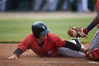 Tyler Osik (9) of the Kannapolis Intimidators tries to touch home plate during the game against the Hagerstown Suns at Kannapolis Intimidators Stadium on August 27, 2019 in Kannapolis, North Carolina. The Intimidators defeated the Suns 5-4. (Brian Westerholt/Four Seam Images)