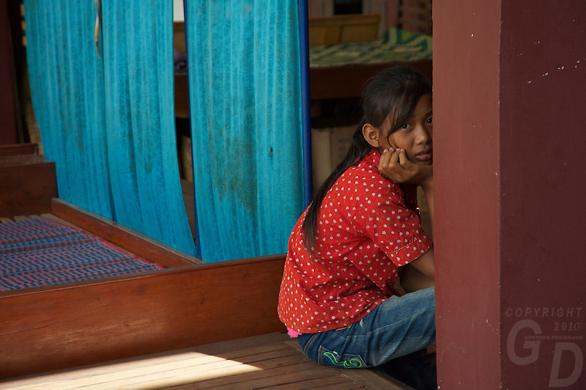 A girl is waiting at a small clinic near the Tonle Sap Lake Cambodia