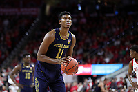 RALEIGH, NC - JANUARY 9: Juwan Durham #11 of the University of Notre Dame takes a free throw during a game between Notre Dame and NC State at PNC Arena on January 9, 2020 in Raleigh, North Carolina.