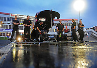 May 13, 2011; Commerce, GA, USA: The  crew for NHRA funny car driver Jim Head wait in the water box during qualifying for the Southern Nationals at Atlanta Dragway. Mandatory Credit: Mark J. Rebilas-
