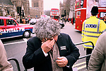 """Augusto Pinochet Extradite dictator back to Chile. Anti Pinochet demonstration Parliament square London England 1999 1990s UK   Chilean man wearing badge """"Extradite Pinochet"""", crying overcome with emotion."""