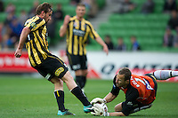MELBOURNE, AUSTRALIA - SEPTEMBER 19, 2010: NIck Ward from the Phoenix kicks the ball as it is saved by Clint Bolton from the Heart in Round 7 of the 2010 A-League between the Melbourne Heart and Wellington Phoenix at AAMI Park on September 19, 2010 in Melbourne, Australia. (Photo by Sydney Low / Asterisk Images)