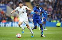 Jack Cork of Swansea City and Ngolo Kante of Leicester City during the Barclays Premier League match between Leicester City and Swansea City played at The King Power Stadium, Leicester on April 24th 2016