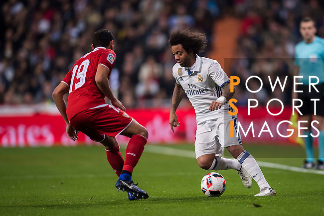 "Marcelo Vieira Da Silva (r) of Real Madrid competes for the ball with Paulo Henrique Chagas de Lima ""Ganso"" of Sevilla FC during their Copa del Rey Round of 16 match between Real Madrid and Sevilla FC at the Santiago Bernabeu Stadium on 04 January 2017 in Madrid, Spain. Photo by Diego Gonzalez Souto / Power Sport Images"