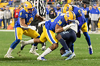 Pitt linebacker Cam Bright (38) makes a tackle. The Pitt Panthers defeated the North Carolina Tarheels 34-27 in overtime in the football game on November 14, 2019 at Heinz Field, Pittsburgh, Pennsylvania.