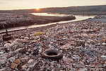 Puget Sound, Snohomish River Estuary, Tulalip Indian Reservation, garbage dump since closed and covered but leaching into the water table, Note the preponderance of plactic garbage bags, Washington State, Pacific Northwest, USA, 1991