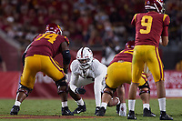 LOS ANGELES, CA - SEPTEMBER 11: Tangaloa Kaufusi #47 of the Stanford Cardinal gets ready for a play during a game between University of Southern California and Stanford Football at Los Angeles Memorial Coliseum on September 11, 2021 in Los Angeles, California.