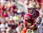 Nyquan Murray looks upfield after catching a 51 yard pass and run for a touchdown in the first half of an NCAA college football game against Syracuse in Tallahassee, Fla., Saturday, Nov. 4, 2017. Florida State defeated Syracuse 27-24.  (AP Photo/Mark Wallheiser)