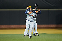 Illinois Fighting Illini outfielders Andrew Dyke (28), Jack Yalowitz (3), and Zac Taylor (37) celebrate their win over the Wake Forest Demon Deacons at David F. Couch Ballpark on February 16, 2019 in  Winston-Salem, North Carolina.  The Fighting Illini defeated the Demon Deacons 5-2. (Brian Westerholt/Four Seam Images)
