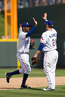 Round Rock Express shortstop Jurickson Profar #10 celebrates with teammate Chris McGuiness after beating the New Orleans Zephyrs 7-1 in a Pacific Coast League baseball game on April 21, 2013 at the Dell Diamond in Round Rock, Texas. (Andrew Woolley/Four Seam Images).