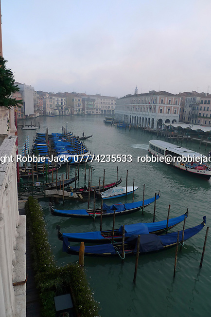 Gondolas and Vaporetto on the Grand Canal in Venice, Italy.
