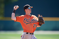 Baltimore Orioles Chris Clare (21) throws to first base during a minor league Spring Training game against the Tampa Bay Rays on March 29, 2017 at the Buck O'Neil Baseball Complex in Sarasota, Florida.  (Mike Janes/Four Seam Images)