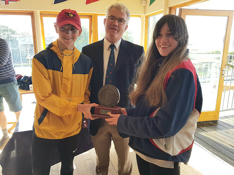 Classic prize - Youth sailors Oscar George and Ella O'Callaghan with Commodore