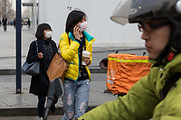 Young women in Beijing's CBD area cross the street. PM2.5 reading - 191 - Unhealthy