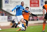 St Johnstone v Dundee United...09.05.15   SPFL<br /> Dave Mackay is tackled by Callum Butcher<br /> Picture by Graeme Hart.<br /> Copyright Perthshire Picture Agency<br /> Tel: 01738 623350  Mobile: 07990 594431