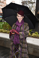 """Patricia Kelly unveils a statue of her husband, Gene Kelly at the launch of """"Scenes in the Square"""" statue trail in Leicester Square, London.<br /> <br /> ©Ash Knotek  D3558 27/02/2020"""