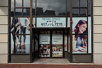 Signs indicate retail space for lease in Kenmore Square in Boston, Massachusetts, on Wed., Jan. 6, 2021.