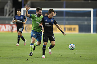 SAN JOSE, CA - OCTOBER 18: Joao Paulo #6 of the Seattle Sounders battles for the ball with Carlos Fierro #21 of the San Jose Earthquakes during a game between Seattle Sounders FC and San Jose Earthquakes at Earthquakes Stadium on October 18, 2020 in San Jose, California.