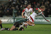 Friday 7th December 2012;  Luke Marshall in action for Ulster is tackled by Saints Tom May during the Pool 4 round 3 Heineken Cup clash at Franklin's Gardens, Northampton, England. Image credit -: JOHN DICKSON / DICKSONDIGITAL
