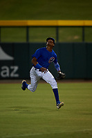 AZL Cubs 1 right fielder Albert Hinirio (22) pursues a fly ball during an Arizona League game against the AZL Angels on June 24, 2019 at Sloan Park in Mesa, Arizona. AZL Cubs 1 defeated the AZL Angels 12-0. (Zachary Lucy / Four Seam Images)