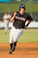 Ian Gac #33 of the Kannapolis Intimidators hustles towards third base against the Greenville Drive at Fieldcrest Cannon Stadium June 3, 2010, in Kannapolis, North Carolina.  Photo by Brian Westerholt / Four Seam Images