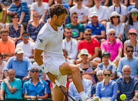 London, England, 5 th. July, 2018, Tennis,  Wimbledon, Men's singles, Robin Haase (NED) hits a tweener<br /> Photo: Henk Koster/tennisimages.com