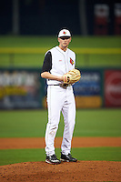 Louisville Cardinals relief pitcher Adam Wolf (31) gets ready to deliver a pitch during a game against the Maryland Terrapins on February 18, 2017 at Spectrum Field in Clearwater, Florida.  Louisville defeated Maryland 10-7.  (Mike Janes/Four Seam Images)