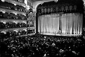 St. Petersburg, Russia  .1998.Ballet dancer Ylyana Lopatkina takes a bow to the crowd at the Mariinsky Theater on the opening night of a new production. She is accompanied on stage by Faruh Rusiematov, a very famous male ballet performer who opened the show with her..