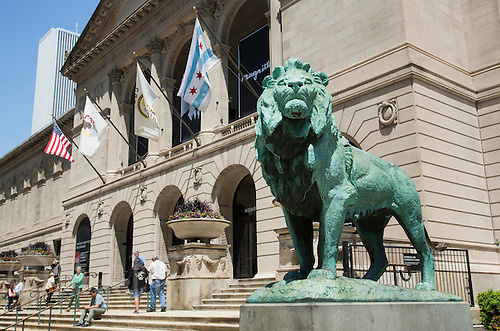 26 JUN 2014 - CHICAGO, USA - One of Edward Kemey's  two bronze lions outside the Art Institute of Chicago on South Michigan Avenue in Chicago in the USA (PHOTO COPYRIGHT © 2014 NIGEL FARROW, ALL RIGHTS RESERVED)