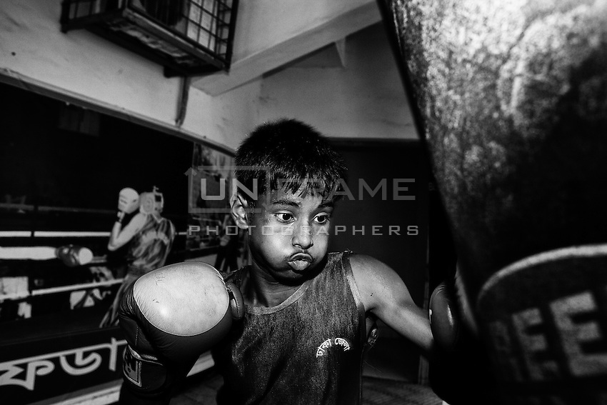 Al-Amin (age 14) practices boxing in the  Mohammad Ali Boxing stadium. Al-Amin's father is a driver and told Al-Amin to leave boxing and find a job but he enjoys more boxing.