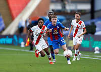 12th September 2020; Selhurst Park, London, England; English Premier League Football, Crystal Palace versus Southampton; Nathan Tella of Southampton and James McCarthy of Crystal Palace chasing for the ball