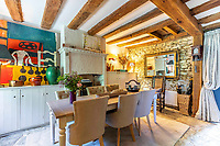 BNPS.co.uk (01202 558833)<br /> Pic: Strutt&Parker/BNPS<br /> <br /> Pitcured: Dining room. <br /> <br /> An 18th century cottage in 'the prettiest village in England' is on the market for £675,000.<br /> <br /> Number 2 School Lane is Grade II listed, built with beautiful Cotswold stone and filled with character features like exposed timber beams and original fireplaces.<br /> <br /> The attractive three-bedroom property is in the highly sought after Wiltshire village of Castle Combe.<br /> <br /> The quintessentially English village has been used regularly as a film location and the houses are mostly made with honey-coloured Cotswold stone.