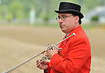09 May 15:   Sam the Bugler gets ready to call the horses to the post for a race on Black-Eyed Susan Day at Pimlico Race Track in Baltimore, Maryland.