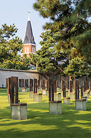 Oklahoma City National Memorial, Oklahoma, USA. Saint Joseph's Old Cathedral in background behind Memorial Chairs.
