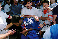 White students attack an African National Congress (ANC) supporter in Pretoria in the dying days of the apartheid era.