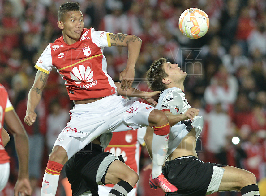 BOGOTÁ-COLOMBIA-22-04-2015. Francisco Meza (Izq) jugador de Independiente Santa Fe de Colombia disputa el balón con Walter Kannemann (Der) jugador de Atlas de Mexico, durante partido por la segunda fase, llave G1, de la Copa Bridgestone Libertadores 2015 jugado en el estadio Nemesio Camacho El Campin de la ciudad de Bogotá. / Francisco Meza (L) player of Independiente Santa Fe of Colombia fights for the ball with Walter Kannemann (R) player of Atlas de Mexico during the match for the second phase, G1 key, of the Copa Bridgestone Libertadores 2015 played at Nemesio Camacho El Campin stadium in Bogota city.  Photo: VizzorImage/ Gabriel Aponte /Staff