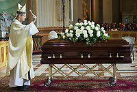 Archbishop of Montreal Christian Lepine blesses the coffin of Paul Gerin-Lajoie during his funeral in Montreal, Thursday, August 9, 2018.THE CANADIAN PRESS/Graham Hughes
