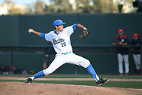 Matt Walker (30) of the UCLA Bruins pitches against the Arizona Wildcats at Jackie Robinson Stadium on March 19, 2017 in Los Angeles, California. UCLA defeated Arizona, 8-7. (Larry Goren/Four Seam Images)