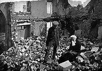 Home Again.  An old French couple visiting their former house in the devastated region, vacated by the Germans, find a mass of stone and debris, representing what was once home to them.  Ca. 1916.  Halftone from Le Monde Illustre.  (War Dept.)<br /> Exact Date Shot Unknown<br /> NARA FILE #:  165-WW-182A-2<br /> WAR & CONFLICT BOOK #:  701