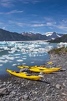 Kayaks on a beach in Bear Glacier Lagoon, Kenai Fjords National Park, southcentral, Alaska.