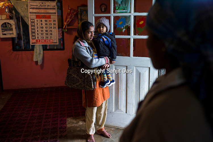Tea planters gather to leave their children at the day care centre before leaving for work in the Pedro Tea Estate in Nuwareliya in Central Sri Lanka.  Photo: Sanjit Das/Panos