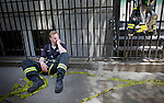New York City Fire Department firefighter Terence O'Donnell rests after working on the scene of a crane collapse on Manhattan's Upper East Side at 91st Street and 1st Avenue on May 30, 2008 in Manhattan, New York. The crane collapsed on top of an apartment building crashing into a penthouse apartment and falling to the ground.   (Photo by Yana Paskova/Getty Images)